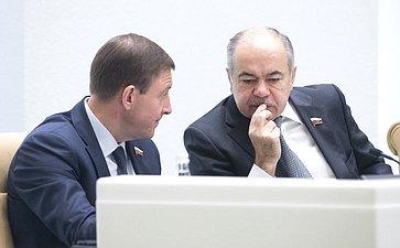 А. Турчак иИ. Умаханов