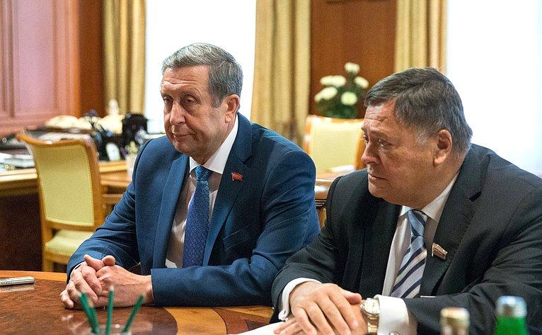 В. Попков иС.Калашников