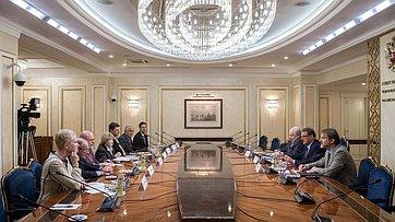 Встреча К. Косачева сделегацией американских экспертов воглаве спрезидентом «Центра национального интереса» Д.Саймсом